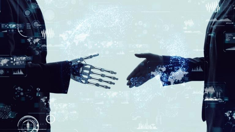 human and robot shake hands
