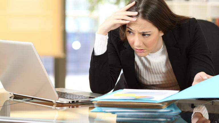 worried woman looking at computer