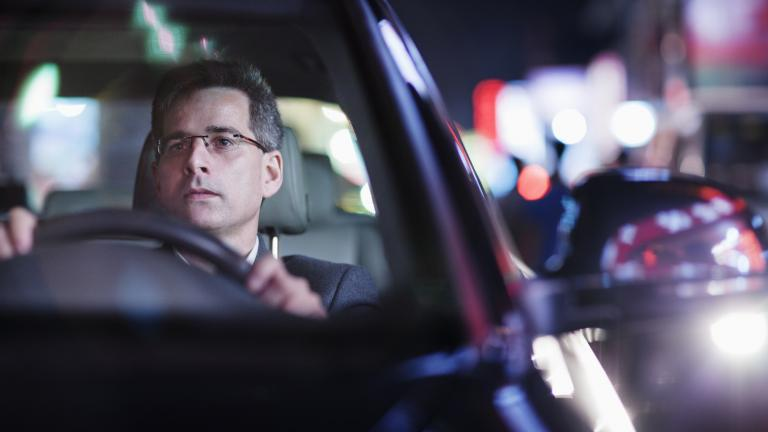 businessman driving at night