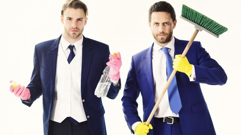 men in suits with cleaning equipment