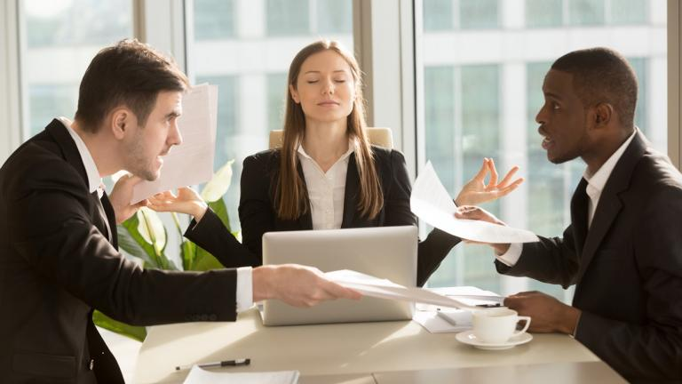clients argue in meeting with calm woman