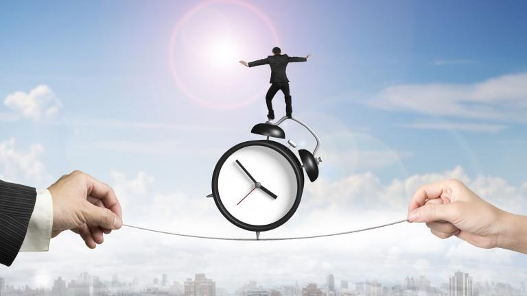 man balancing on clock and tightrope
