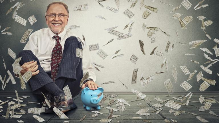 man with piggy bank raining money