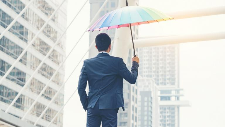 business man with colored umbrella