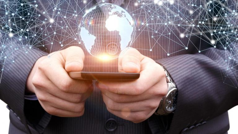 person holding smartphone with digital imagery