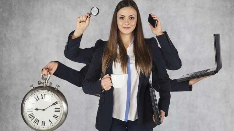 business woman holding many items with many arms