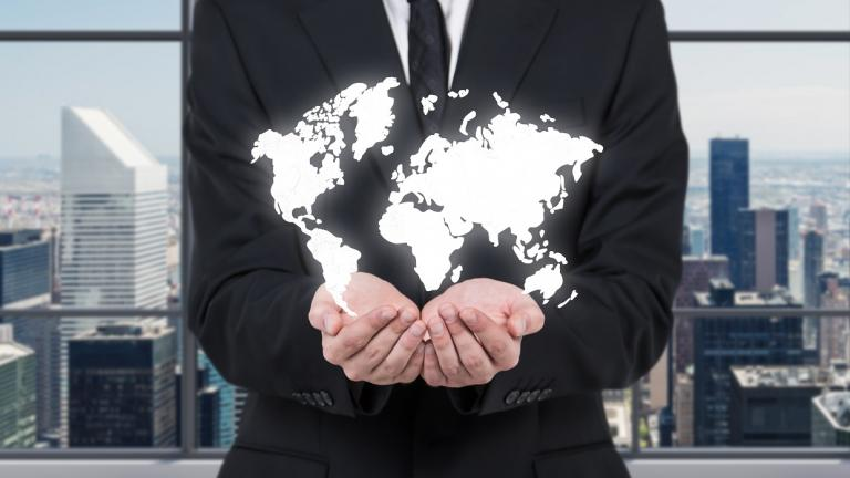 man with hands under global map