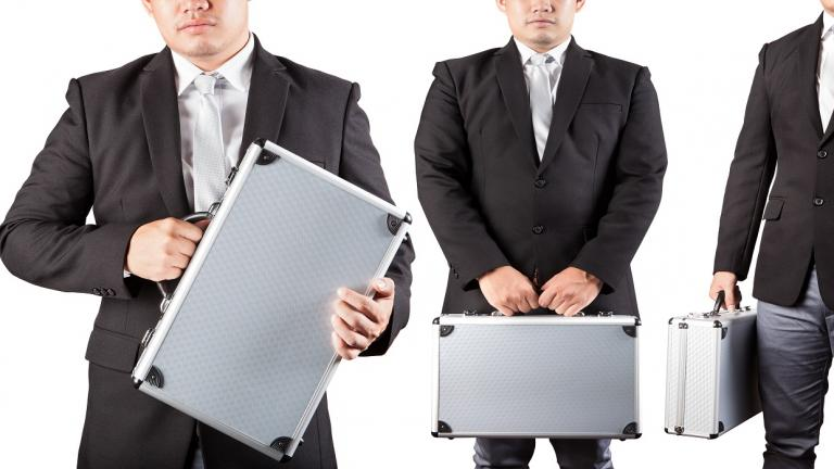3 men hold metal briefcases