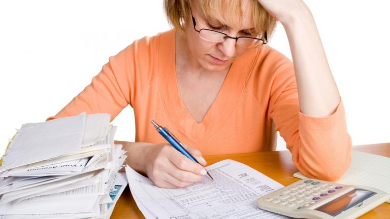 woman filing out IRS forms