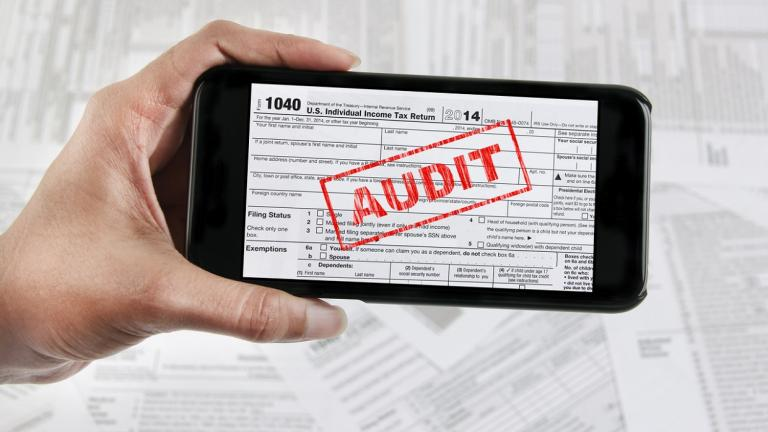 IRS audit notice on smartphone