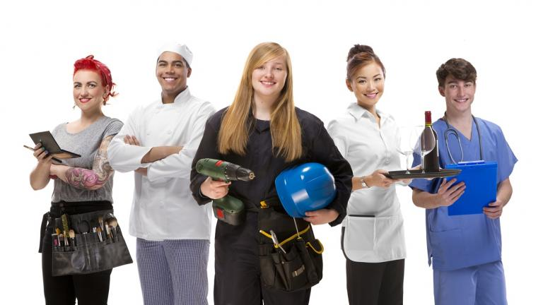 Young men and women in various work uniforms
