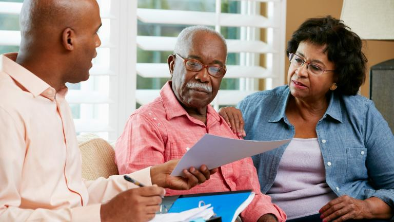 elderly couple speak with planner