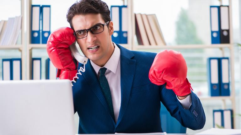 angry man on phone with boxing gloves