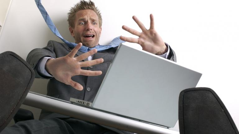 man screaming at laptop screen