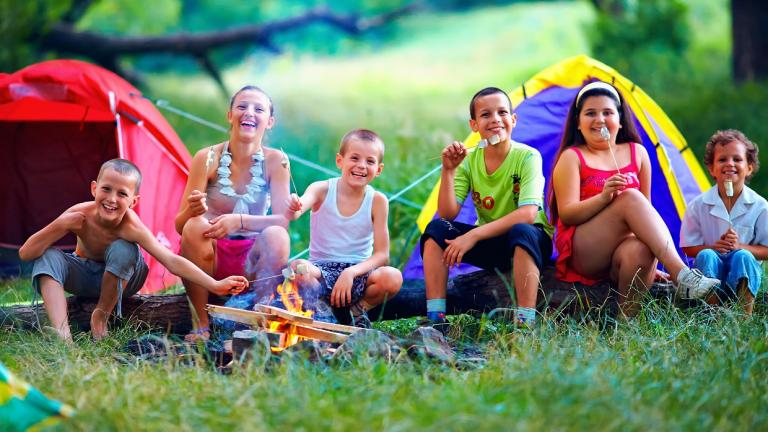 happy kids in front of a campfire