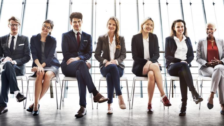 young businesspeople sitting in a room