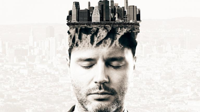 man's with buildings growing out of his head