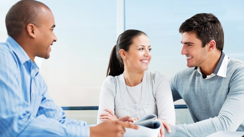 couple meeting with business advisor