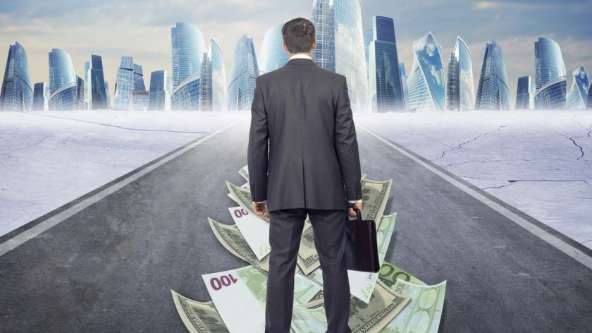 man on road paved with money