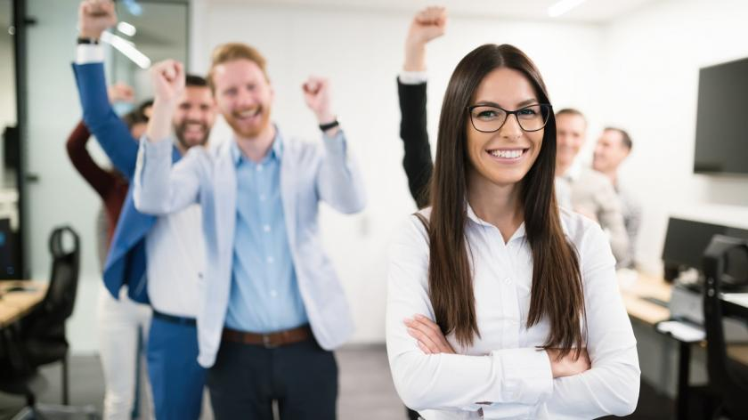 happy office people behind female manager