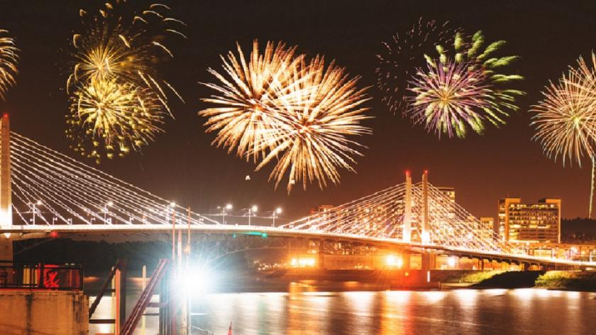 fireworks at night over bridge