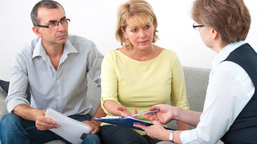 concerned couple speaking to advisor