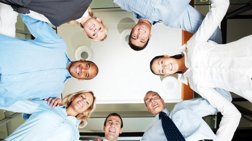 co-workers huddle in a circle