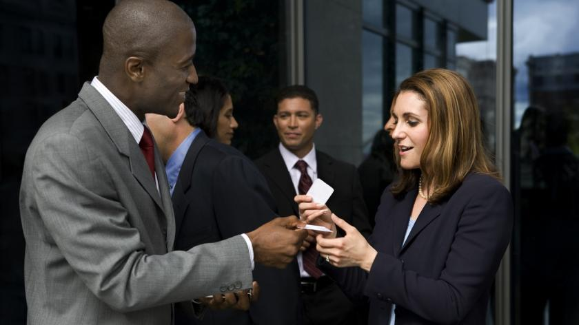 exchanging business cards at networking event