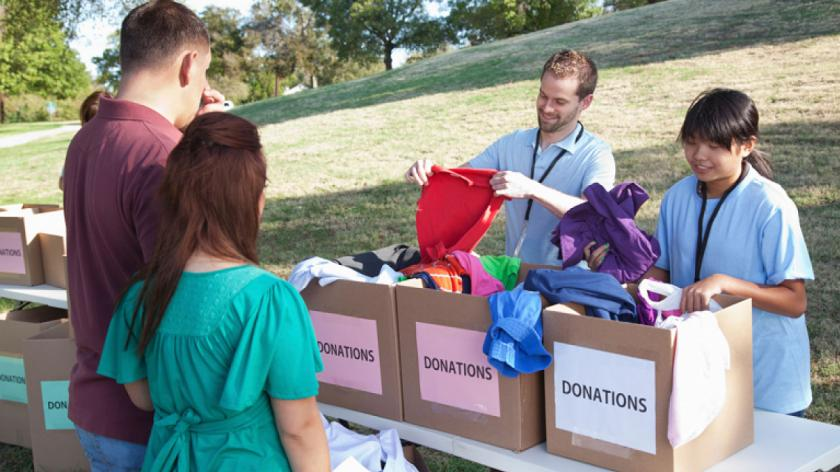 people donating clothing to charity