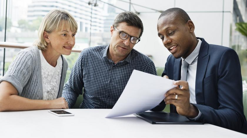 business man showing document to clients