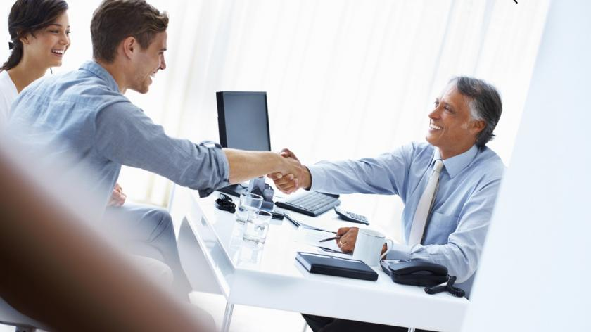 man shaking hands with his clients