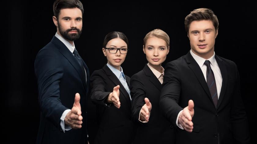 business people extend hands