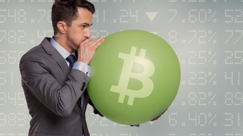 man inflating bitcoin balloon