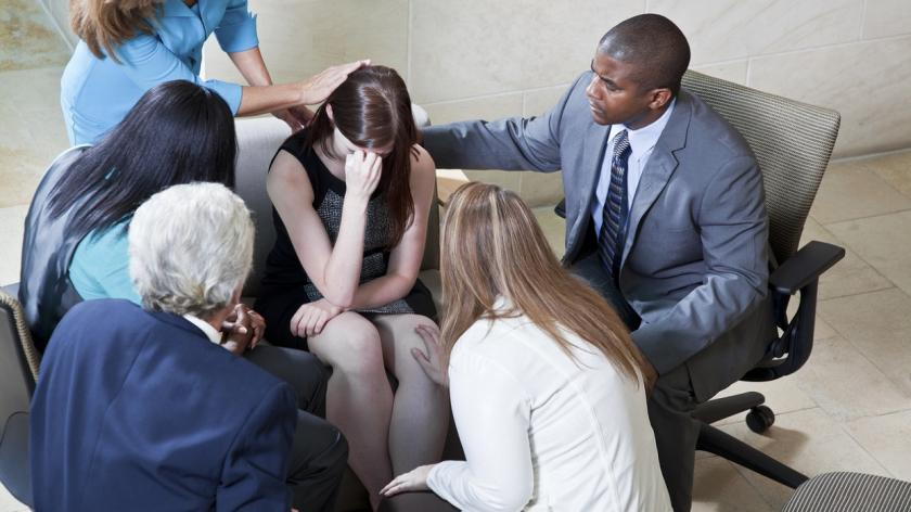 group consoles grieving woman