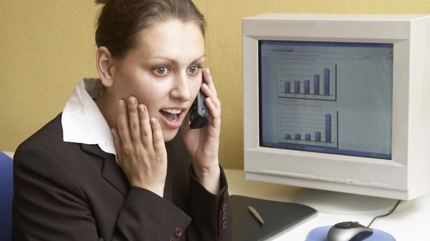 woman on phone with expense reports