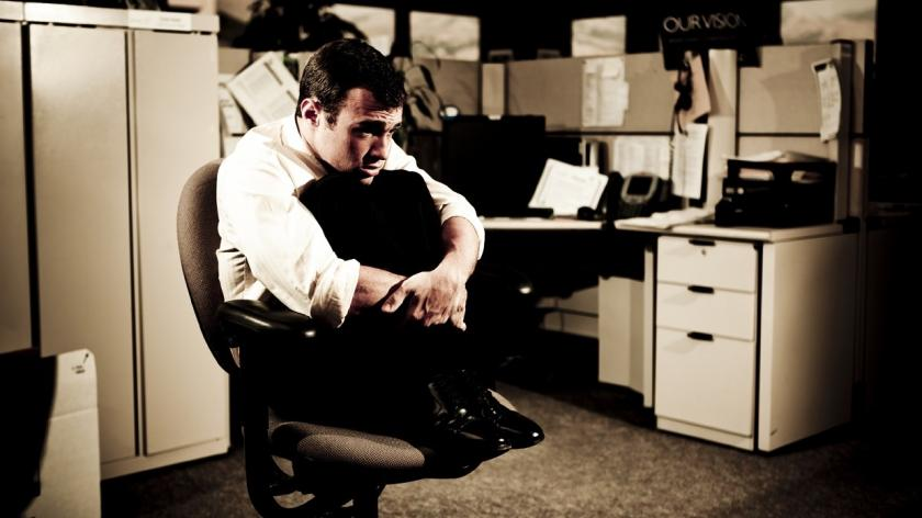 fearful man in office chair