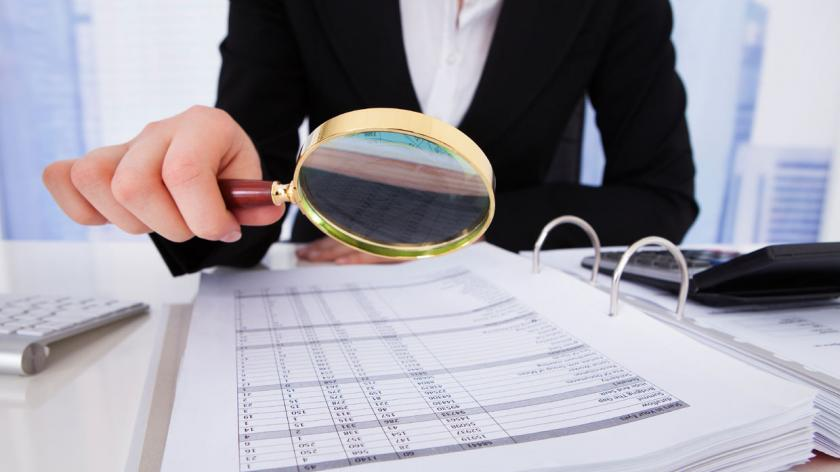magnifying glass fraud