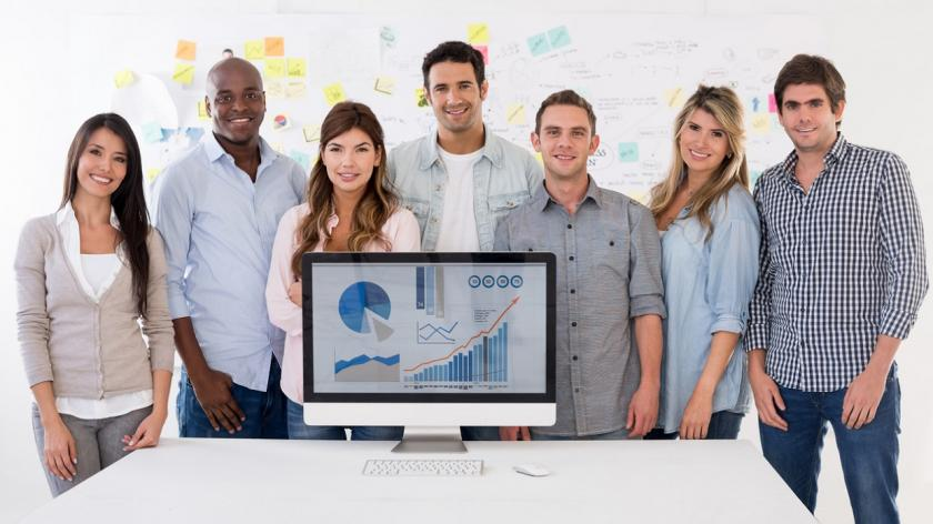 multicultural people stand in front of growth chart screen