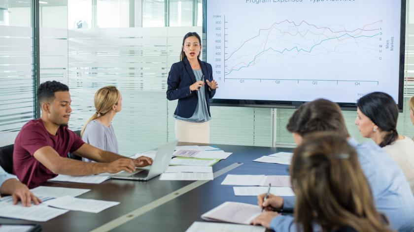 woman in meeting in front of growth chart