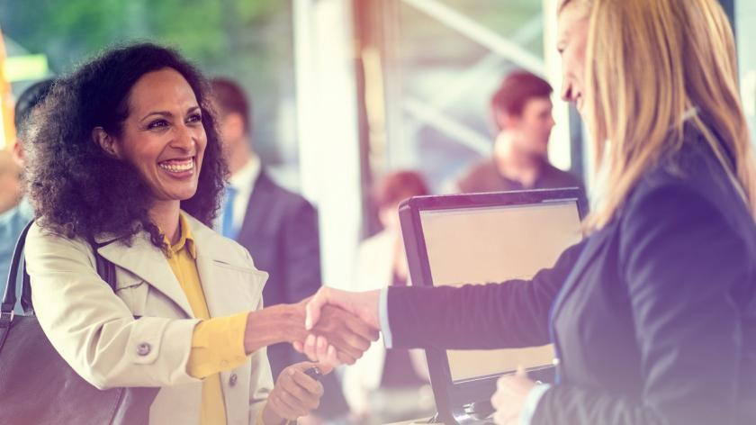 woman shaking hands with happy customer