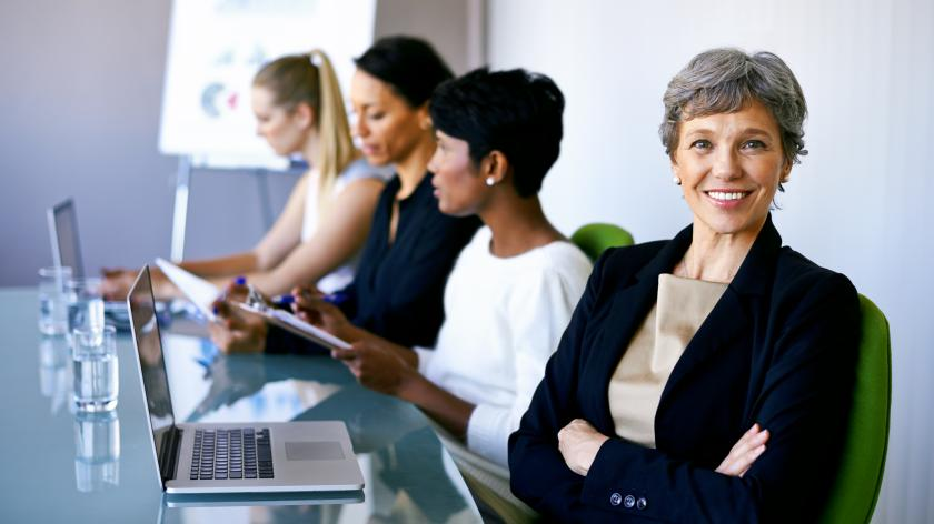 Group of businesswomen at a conference table