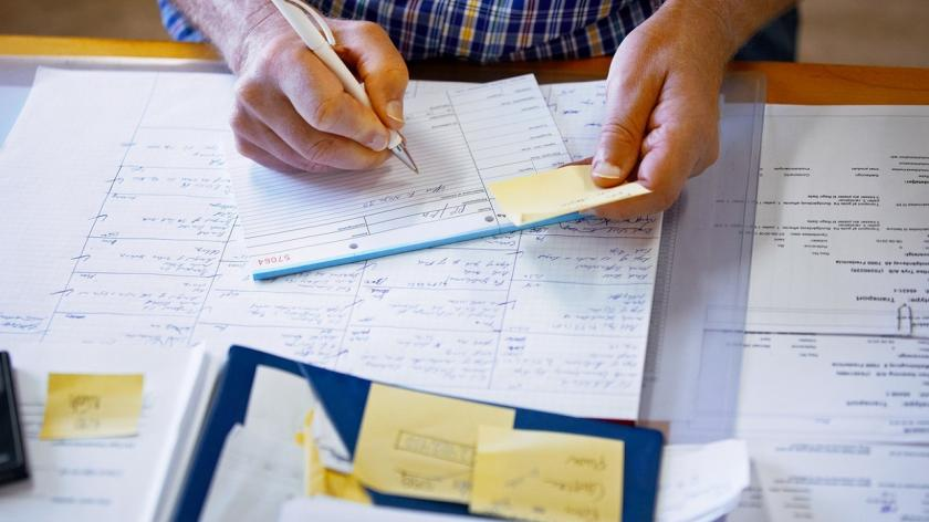 person filling out loan documents