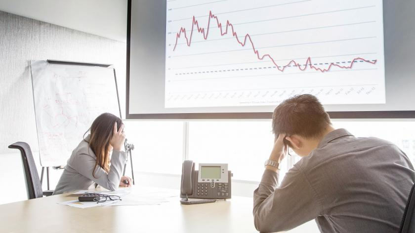 worried man and woman in room with growth chart