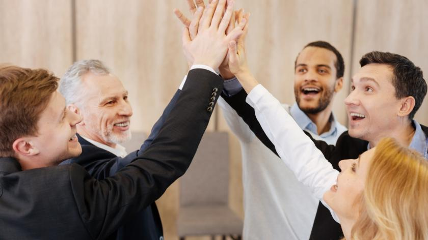 happy co-workers high five