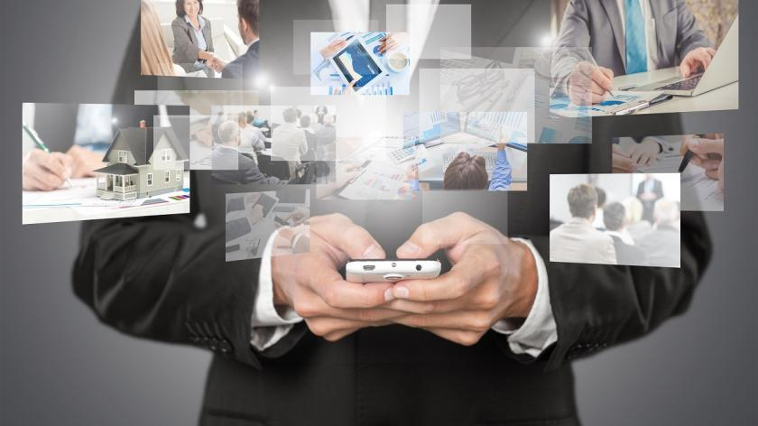 man with phone and business images