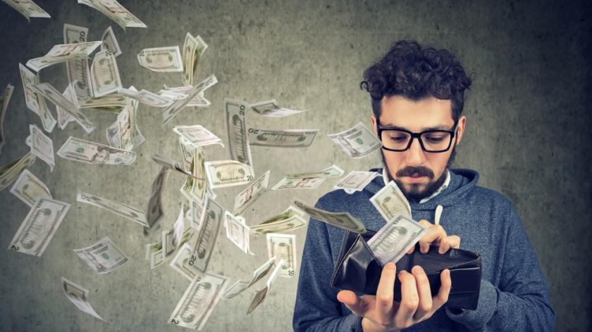 money flying out of man's wallet