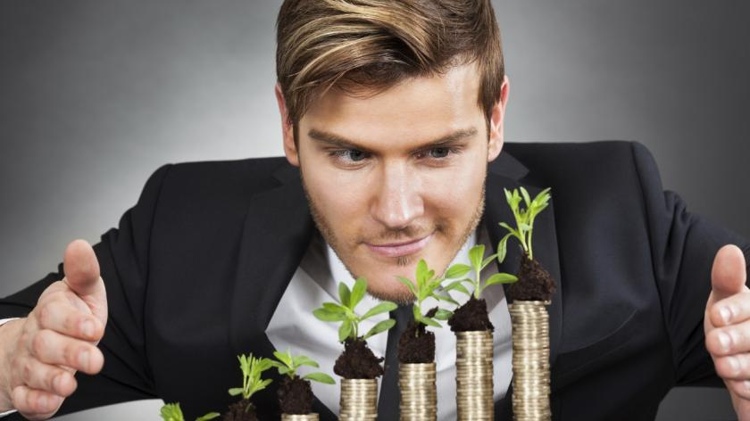 man with plants growing from coins
