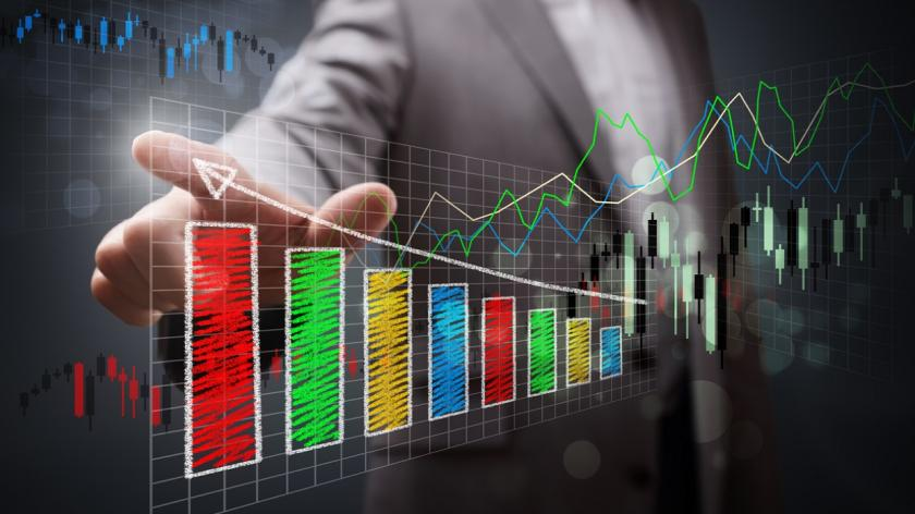 business person showing growth charts
