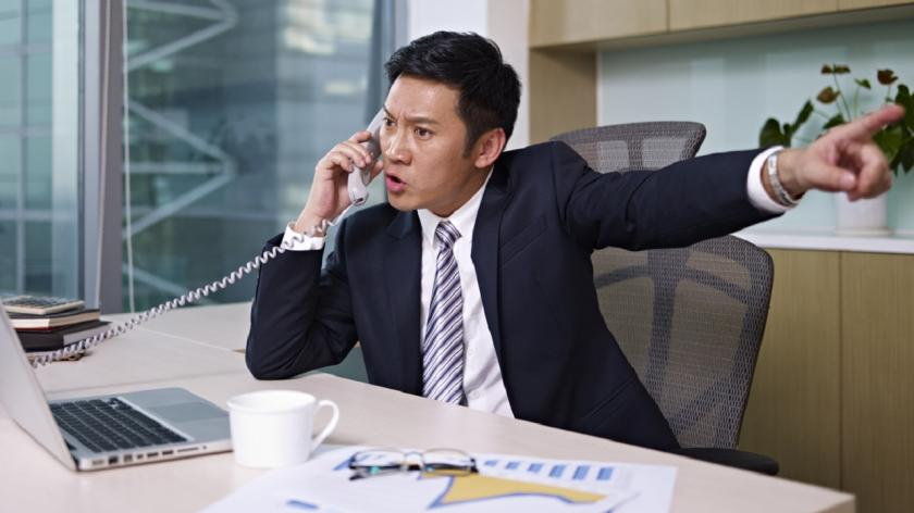 business man yelling on the phone