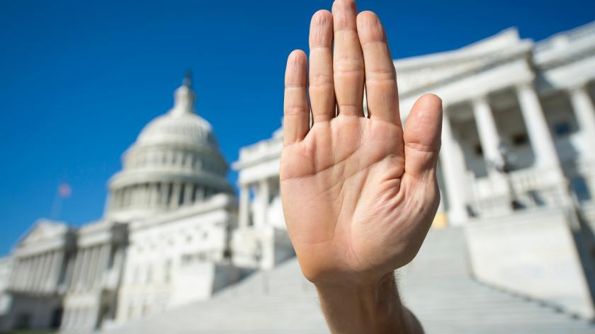 hand in front of capitol building